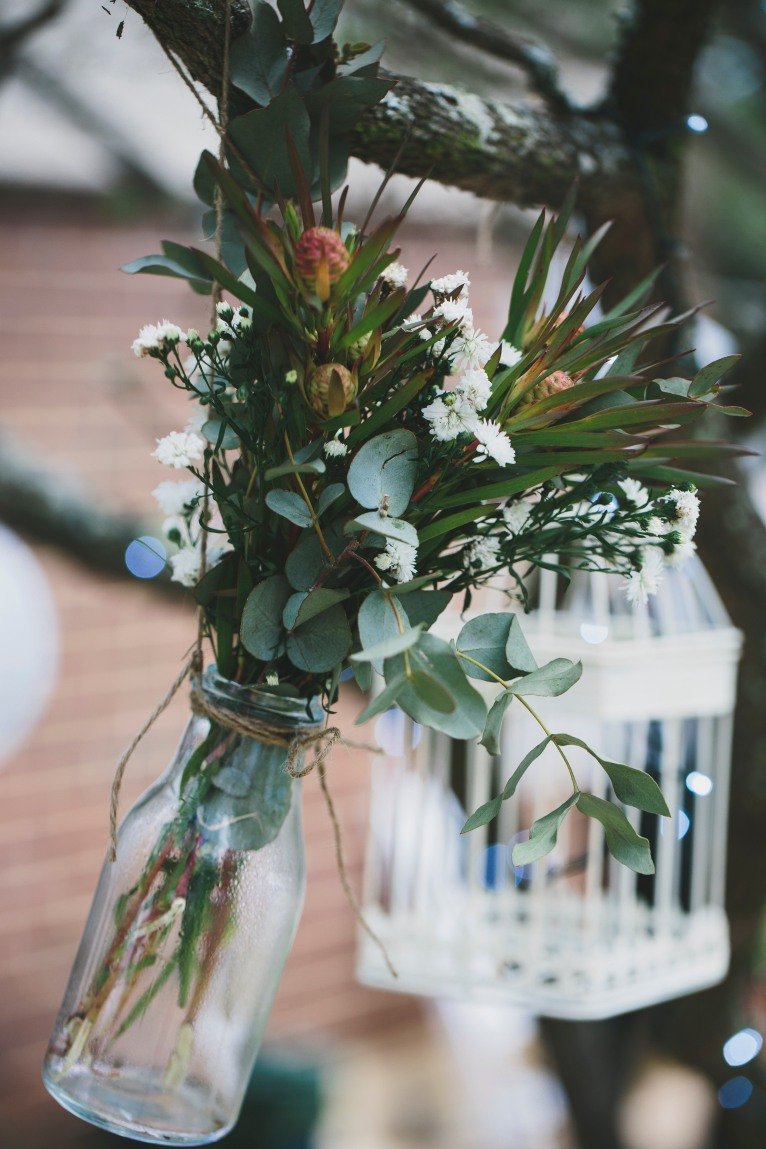 Hanging jars with loose florals great outdoor styling idea. Photo: David James Photography.